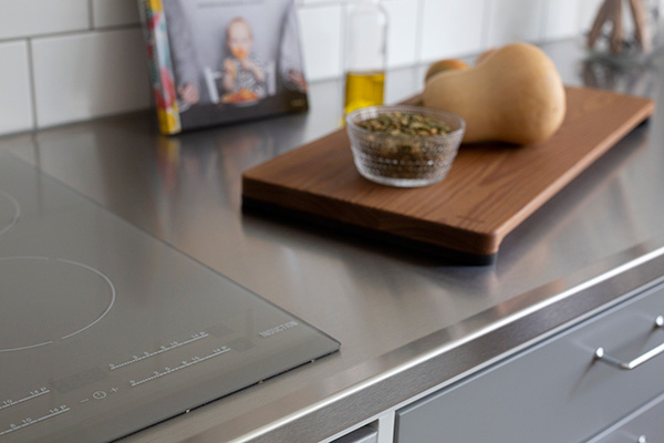 The grey cook top blends in well with the stainless steel, and it adds something to the kitchen.