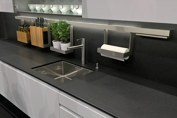 Undermounted kitchen sink in grey kitchen worktop