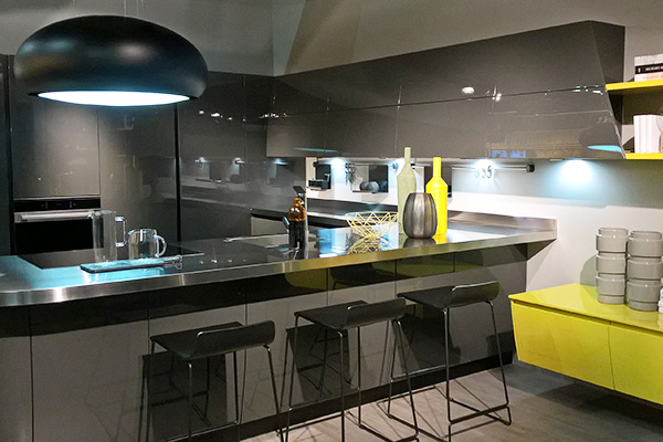 Grey kitchen with stainless steel worktop
