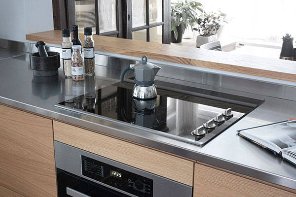 The Miele cooktop is installed into the stainless steel worktop, which can handle all the splatter made from cooking