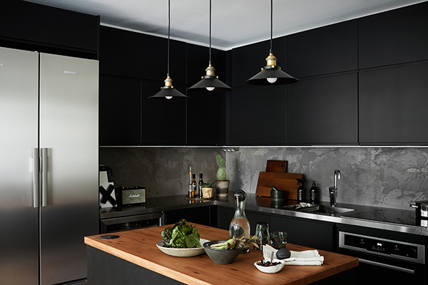 The dark cupboards were found in the kitchen collection of Domus and the appliances were from Gigantti