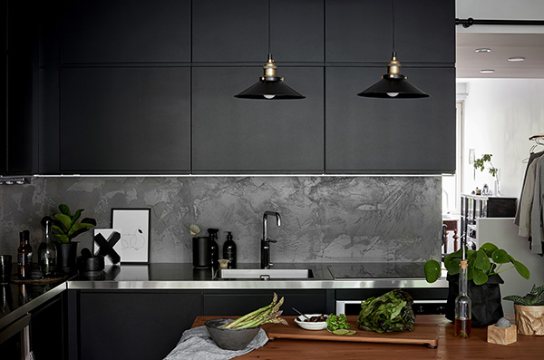 Dramatically dark and functionally compact kitchen